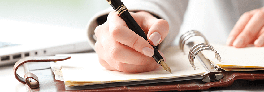 image showing person writing a will