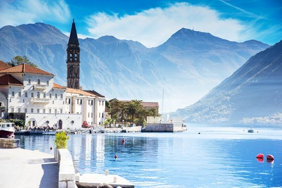 Montenegro, Kotor Bay - Coastline surrounded by mountains.