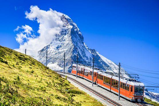 Gornergrat train through Matterhorn mountains in Switzerland