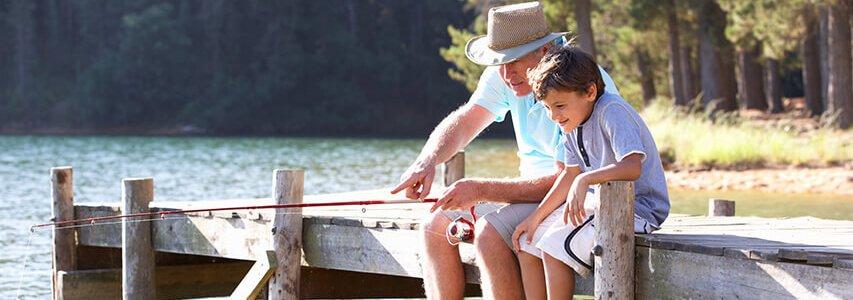 Grandparent fishing with grandchild