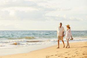 Retired couple enjoying a European beach