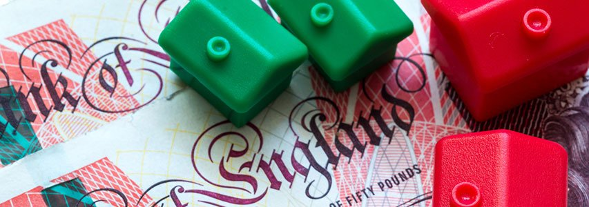 Equity release lending represented by monopoly houses on fifty pound notes