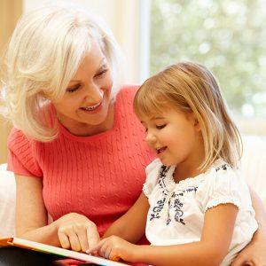 Grandparent with Grandchild, reading a book