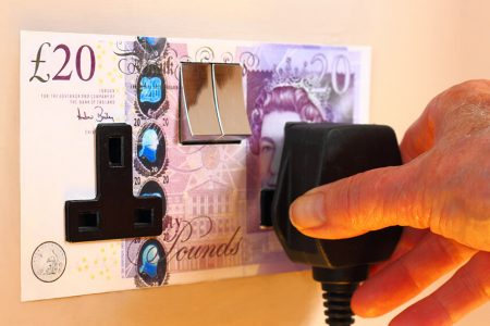20 pound note plug socket representing high energy prices