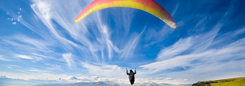 Retirement Bucket list #16 - Paragliding retiree against a blue sky