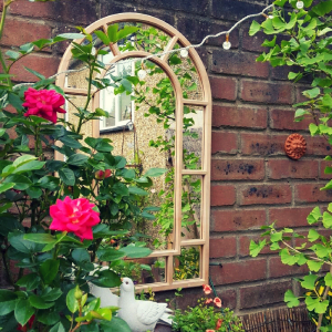 Mirror on a garden wall