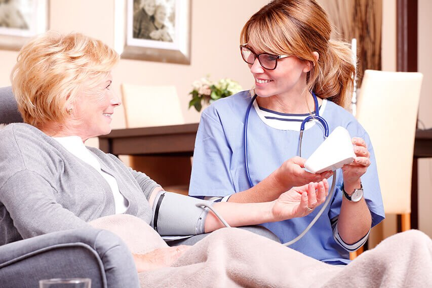 Retired lady receiving home care from a nurse
