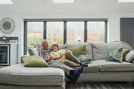 Retired couple relaxing on a sofa