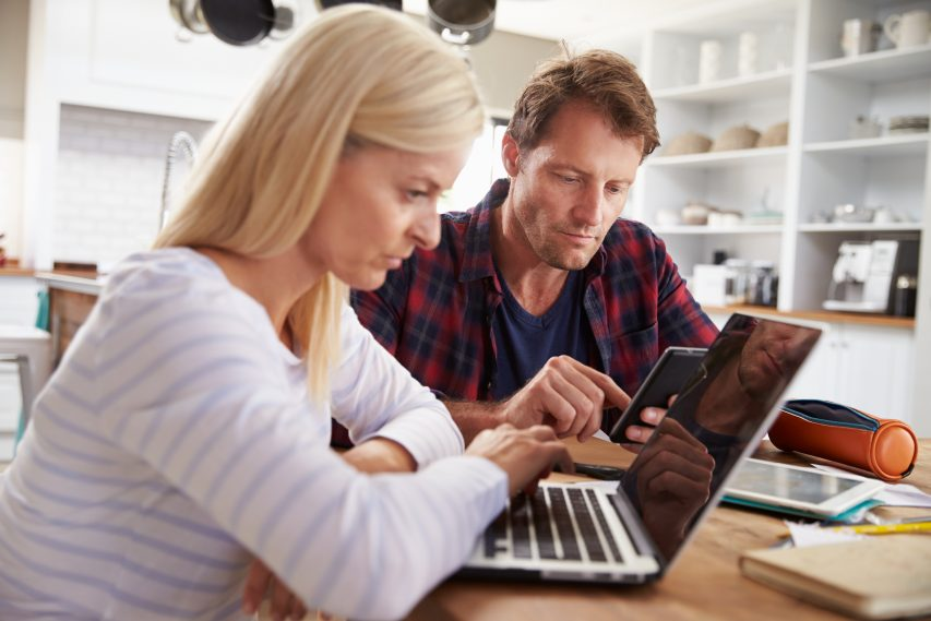 Couple doing financial review of monthly outgoings